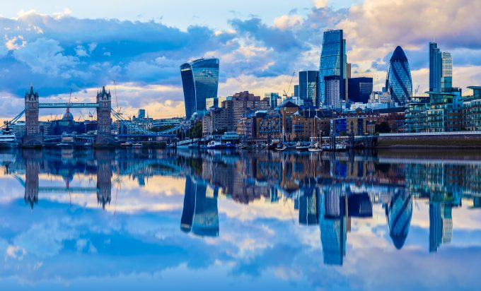 London cityscape and its reflection from river Thames at sunset